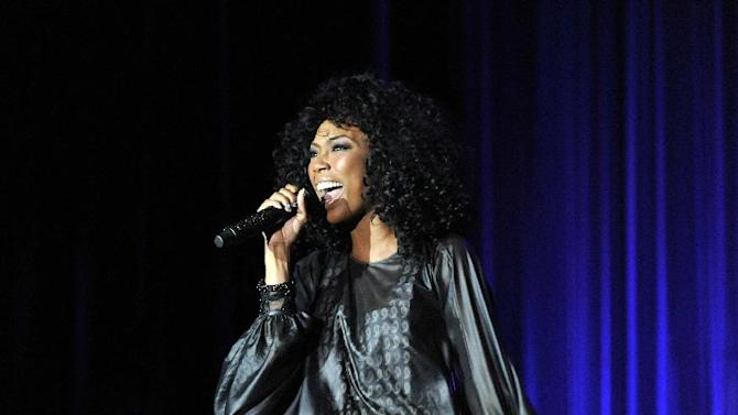 "R&B star Brandy performs at the AIDS Healthcare Foundation's ""Keep The Promise On AIDS"" March and Rally, on Saturday, May 11, 2013 in Cleveland, Ohio. (David Richard /AP Images for AIDS Healthcare Foundation)"