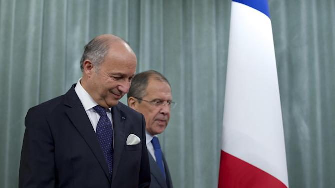 French Foreign Minister Laurent Fabius, left, and his Russian counterpart Sergey Lavrov arrive for a news conference after their meeting in Moscow, Russia, on Tuesday, Sept. 17, 2013. Moscow is insisting that a new United Nations resolution on Syria not allow the use of force, but Russia's foreign minister appears to suggest the issue could be reconsidered if Syria violates an agreement on abandoning its chemical weapons. (AP Photo/Ivan Sekretarev)