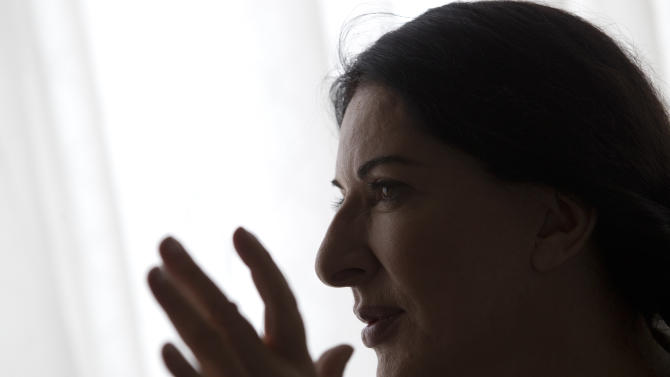 "Performance artist Marina Abramovic speaks during an interview at the Rio Film Festival in Rio de Janeiro, Brazil, Thursday, Oct. 4, 2012. The Belgrade-born artist is best known for her piece ""The Artist Is Present,"" which in 2010 saw her sit silent and motionless for 736.5 hours opposite a parade of strangers at New York's Museum of Modern Art. The film is playing at the 2012 Rio de Janeiro International Film Festival. (AP Photo/Silvia Izquierdo)"