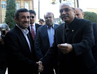 Iran's President Mahmoud Ahmadinejad (left) shakes hands with his Pakistani counterpart Asif Ali Zardari prior to talks in Tehran, on February 27, 2013. Iran's supreme leader Ayatollah Ali Khamenei on Wednesday told the visiting Pakistani president that a much-delayed $7.5 billion gas pipeline project must go ahead despite US opposition