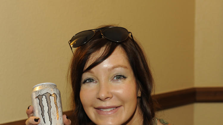 Actress Holly Fields visits holds Monster energy drink at the Fender Music lodge during the Sundance Film Festival on Monday, Jan. 21, 2013, in Park City, Utah. (Photo by Jack Dempsey/Invision for Fender/AP Images)