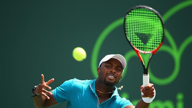 Donald Young of the United States plays a forehand to Andy Murray of Great Britain in their second round match during the Miami Open on March 27, 2015 in Key Biscayne, Florida