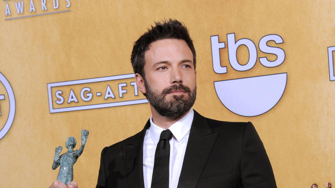 """Actor Ben Affleck poses backstage with the award for best cast in a motion picture for """"Argo"""" at the 19th Annual Screen Actors Guild Awards at the Shrine Auditorium in Los Angeles on Sunday Jan. 27, 2013. (Photo by Chris Pizzello/Invision/AP)"""