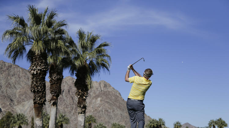 Russell Henley hits his tee shot on the third hole during the second round of the Humana Challenge golf tournament on the Palmer Private course at PGA West in La Quinta, Calif. Friday, Jan. 18, 2013. (AP Photo/Chris Carlson)