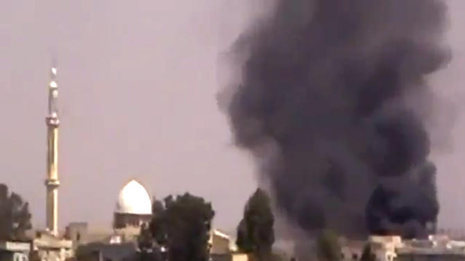 This image made from amateur video provided by Shaam News Network and accessed by the Associated Press on Friday, Sept. 8, 2012 purports to show smoke from intense shelling in the Tel Chehab area of Daraa, Syria. Activists have reported clashes between troops and rebels in a southern neighbourhood of the capital, Damascus. The Britain-based Syrian Observatory for Human Rights and Local Coordination Committees had no immediate word on casualties from Friday's clashes in Kazaz. The Observatory reported many arrests in the town of Tel Chehab on the border with Jordan, recaptured by troops Thursday. (AP Photo/Shaam News Network SNN via AP video)THE ASSOCIATED PRESS HAS NO WAY OF INDEPENDENTLY VERIFYING THE CONTENT, LOCATION OR DATE OF THIS PICTURE.