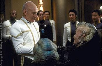 Patrick Stewart as Captain Picard meeting an esteemed alien life form in Star Trek: Insurrection