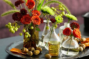 Garden Centerpiece: Grab a few bottles and a handful of wildflowers to create this rich colorful centerpiece. Save a few little buds to add to place settings as well.