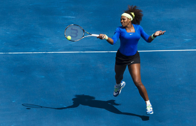 Serena Williams from U.S. returns the ball to Elena Vesnina from Russia during the Madrid Open tennis tournament, in Madrid, Monday, May 7, 2012. (AP Photo/Daniel Ochoa de Olza)