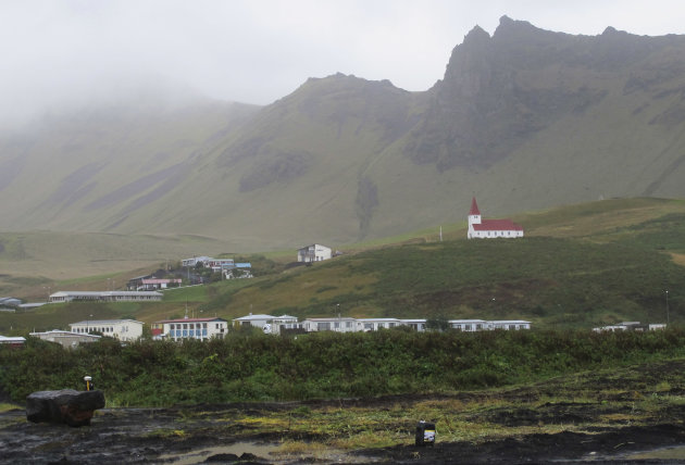 Vik, a small Icelandic town of just 300 people, where residents still recall stories from their relatives of Katla volcano&#39;s last eruption in 1918, sits under a blanket of cloud in this Sept. 27, 2011 photo. If Iceland&#39;s air-traffic paralyzing volcanic eruption in 2011 seemed catastrophic, just wait for the sequel. That&#39;s what many experts are saying as they nervously watch rumblings beneath a much more powerful Icelandic volcano - Katla - which could spew an ash cloud dwarfing eruption that cost airlines $2 billion and drove home how vulnerable modern society is to the whims of nature.(AP Photo/Paisley Dodds)