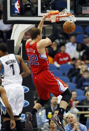 Griffin, Clippers overwhelm Love-less Wolves
