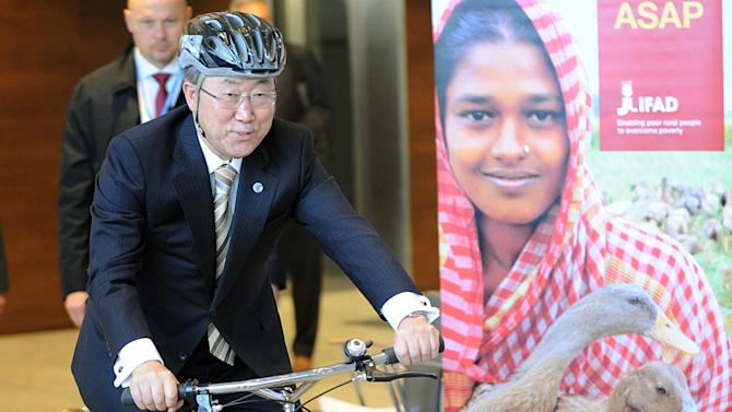 United Nations Secretary General Ban Ki-moon rides a bike made of bamboo during a meeting with the Ghana Bamboo Bike initiative, at the UN Climate Conference in Warsaw, Poland, Wednesday, Nov. 20, 2013. (AP Photo/Alik Keplicz)