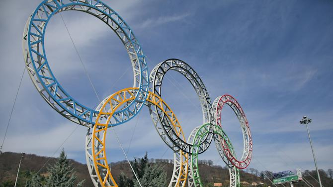 Olympic rings for the 2014 Winter Olympics are installed in the Black Sea resort of Sochi, southern Russia, late Tuesday, Sept. 25, 2012.  With the Winter Olympics a year away, IOC President Jacques Rogge praised Sochi organizers on Wednesday, Feb. 6, 2013 and defended the $51 billion price tag. (AP Photo/Ignat Kozlov))