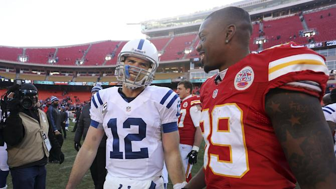Indianapolis Colts quarterback Andrew Luck, left, talks with Kansas City Chiefs wide receiver Jon Baldwin after an NFL football game Sunday, Dec. 23, 2012, in Kansas City, Mo. The Colts won 20-13. (AP Photo/Ed Zurga)