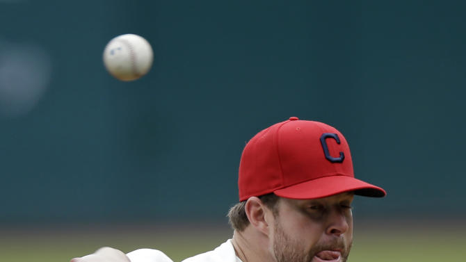 Cleveland Indians starting pitcher Corey Kluber delivers against the Washington Nationals in the first inning of a baseball game on Sunday, June 16, 2013, in Cleveland. (AP Photo/Mark Duncan)