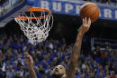 Kentucky's Willie Cauley-Stein, left, reaches for a rebound over Arkansas' Bobby Portis during the first half of an NCAA college basketball game, Saturday, Feb. 28, 2015, in Lexington, Ky. (AP Photo/James Crisp)