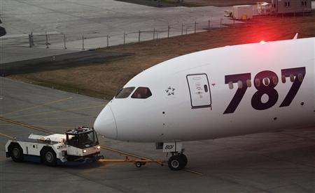 File photo of Boeing 787 Dreamliner airframe #8 being tugged out for takeoff from Paine Field in Everett