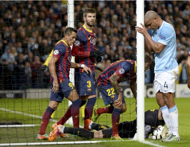 Manchester City's Vincent Kompany reacts after a missed opportunity during their Champions League round of 16 first leg soccer match against Barcelona at the Etihad Stadium in Manchester