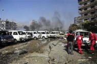 Damaged vehicles and the Russian embassy building (rear C) are seen after an explosion in central Damascus February 21, 2013, in this handout photograph released by Syria&#39;s national news agency SANA. REUTERS/Sana