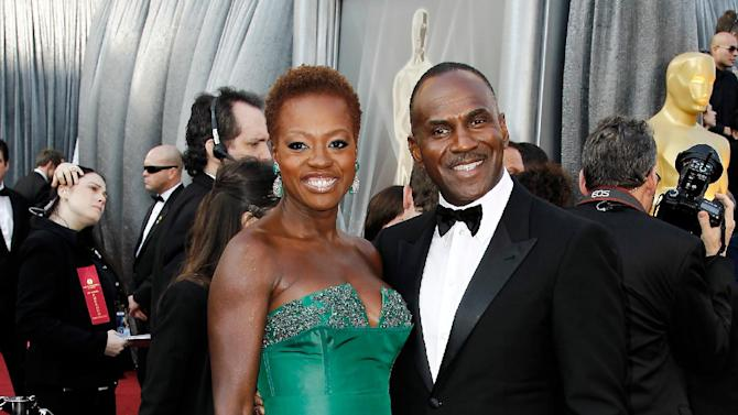 Viola Davis, left, and Julius Tennon arrive before the 84th Academy Awards on Sunday, Feb. 26, 2012, in the Hollywood section of Los Angeles. (AP Photo/Matt Sayles)
