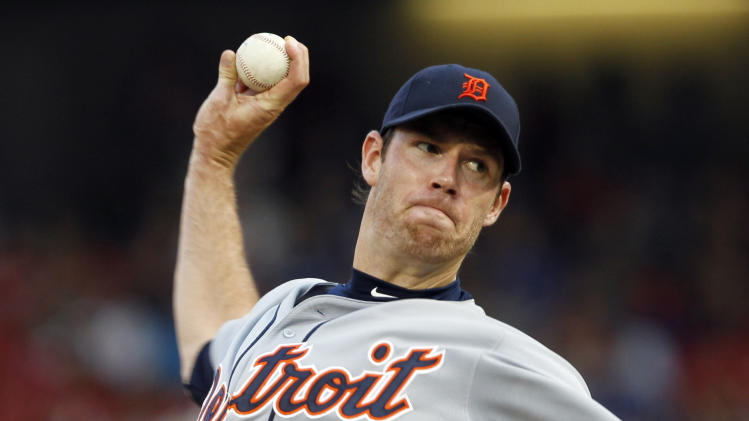Detroit Tigers starting pitcher Doug Fister  throws a pitch during the first inning of a baseball game against the Texas Rangers on Sunday, May 19, 2013, in Arlington.  (AP Photo/John F. Rhodes)