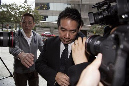 Former Birmingham City Football Club owner Carson Yeung arrives at a district court in Hong Kong