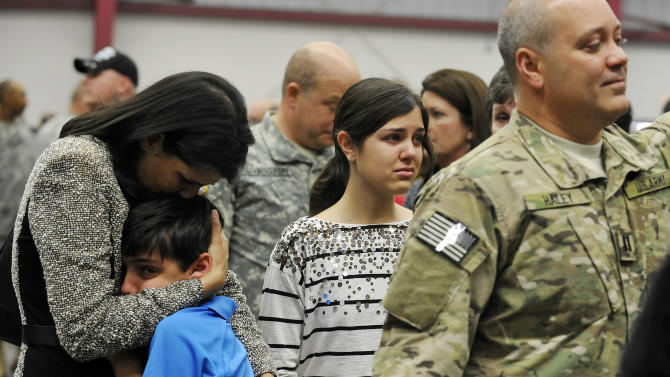 South Carolina Gov. Nikki Haley, left, comforts her son, Nalin, 10, and her daughter, Rena, 14, as her husband, Capt. Michael Haley, right, gets ready for a deployment ceremony for the South Carolina Army National Guard 3/49 Agribusiness Development Team at McCrady Training Center, Thursday, Jan. 10, 2013, at Ft. Jackson, S.C. The deployment is scheduled for a year including one month of training in Indiana prior to leaving for Afghanistan. (AP Photo/Rainier Ehrhardt)