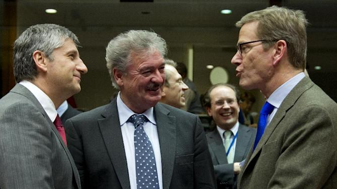 From left, Austria's Foreign Minister Michael Spindelegger, Luxembourg's Foreign Minister Jean Asselborn and German Foreign Minister Guido Westerwelle share a word during a meeting of EU foreign ministers at the EU Council building in Brussels on Monday, Dec. 10, 2012. The 27 EU foreign ministers will discuss the situation in Syria, where activists say more than 40,000 people have died. (AP Photo/Virginia Mayo)