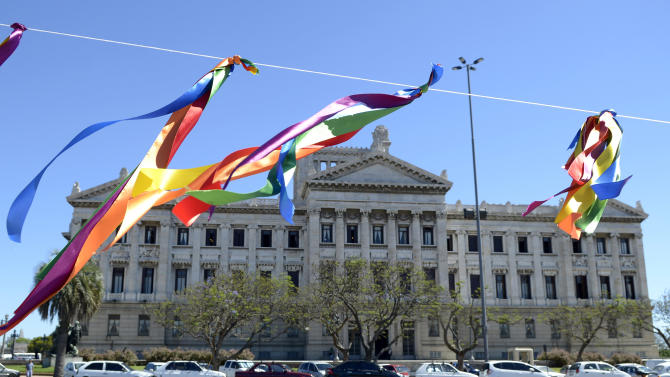 Gay pride ribbons hang outside Parliament where lawmakers are debating a same sex marriage law in Montevideo, Uruguay, Tuesday, Dec. 11, 2012. Taboo-breaking Uruguay is poised to legalize gay marriage, with lawmakers debating Tuesday whether to create a single law governing marriage for heterosexuals and homosexuals.  The new proposal would make Uruguay the second nation in Latin America and the 12th in the world to legalize gay marriage, after The Netherlands, Belgium, Spain, Canada, South Africa, Norway, Sweden, Portugal, Iceland, Argentina and Denmark. (AP Photo/Matilde Campodonico)