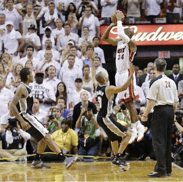In this June 19, 2013 file photo, Miami Heat shooting guard Ray Allen (34) shoots a three-point basket in the final seconds of regulation during the second half of Game 6 of the NBA Finals basketball