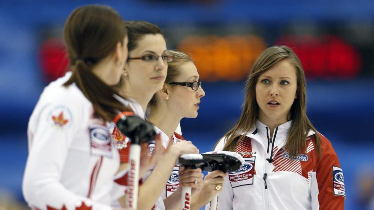Canada's skip Rachel Homan speaks to her teammates during her draw against Denmark at the World Women's Curling Championships in St. John