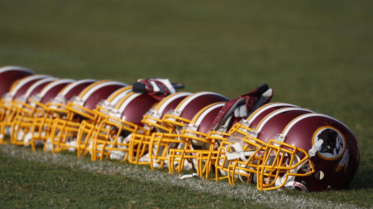 FILE - In this Aug. 4, 2009, file photo, Washington Redskins helmets are displayed on the field during NFL football training camp at Redskins Park in Ashburn, Va. The Oneida Indian Nation tribe in upstate New York said Thursday, Sept. 5, 2013, it will launch a radio ad campaign pressing for the Washington Redskins to get rid of a nickname that is often criticized as offensive. (AP Photo/Pablo Martinez Monsivais, File)