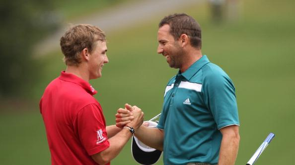 Bud Cauley (L) and Sergio Garcia shake hands on the 18th green during the final round of the Wyndham Championship at Sedgefield Country Club on August 20, 2012 in Greensboro, North Carolina. (Photo by Hunter Martin/Getty Images)