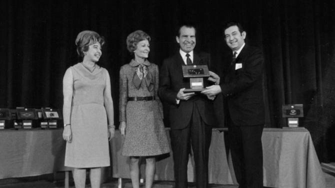 FILE - In this Dec. 3, 1969 file photo provided by the Richard Nixon Presidential Library, President Richard Nixon presents moon rocks to then Governor of Alaska Keith Miller, right, as Pat Nixon, second left, and Diana Miller look on at the Governors Conference in Washington. The rocks disappeared after a museum fire in 1973 but were returned to Alaska on Wednesday, Dec. 5, 2012.   (AP Photo/Richard Nixon Presidential Library, Robert L. Knudsen)
