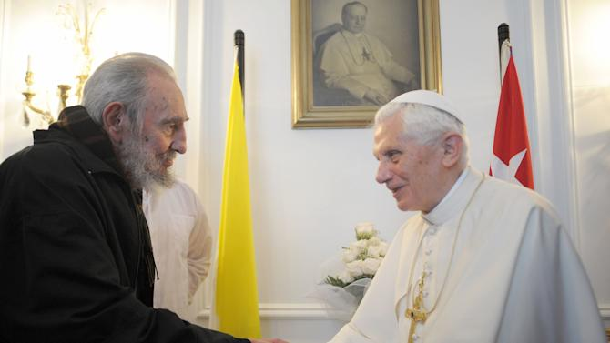 """FILE - In this March 28, 2012 file photo made available by the Vatican newspaper Osservatore Romano, Pope Benedict XVI, right, meets with Fidel Castro in Havana. The Cuban government-run newspaper Granma published a letter dated Wednesday, Oct. 17, 2012 signed by Fidel Castro, the first by the 86-year-old former president since June. Castro has not been seen in public since greeting a visiting Pope Benedict XVI in late March, and the last of his essays known as """"Reflections"""" was published June 19. (AP Photo/Osservatore Romano, File)"""