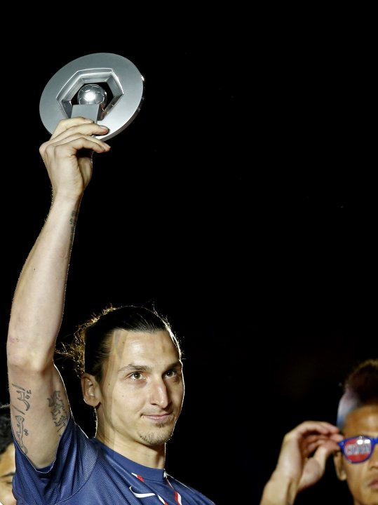Paris Saint-Germain's Ibrahimovic raises his French Championship trophy at the end of their team's French Ligue 1 soccer match against Brest at the Parc des Princes stadium in Paris