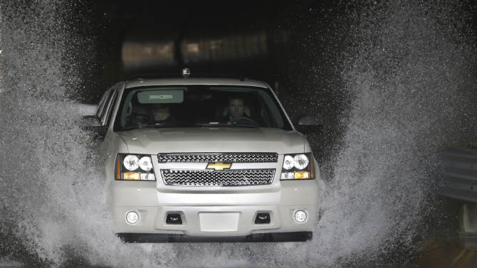 "In a Jan. 17, 2013 photo, a Chevrolet Suburban is driven through the flood test at the General Motors Milford Proving Grounds in Milford, Mich.  It's in this northwest Detroit suburb that GM has its testing facility, which, according to GM consumer affairs chief James Bell, exists for the purpose of beating ""the heck out of a vehicle before the customer can.Ó Founded in 1924, the 4,000-acre Milford Proving Grounds was the first dedicated automotive testing facility in the world, and remains one of the largest to this day. (AP Photo/Carlos Osorio)"