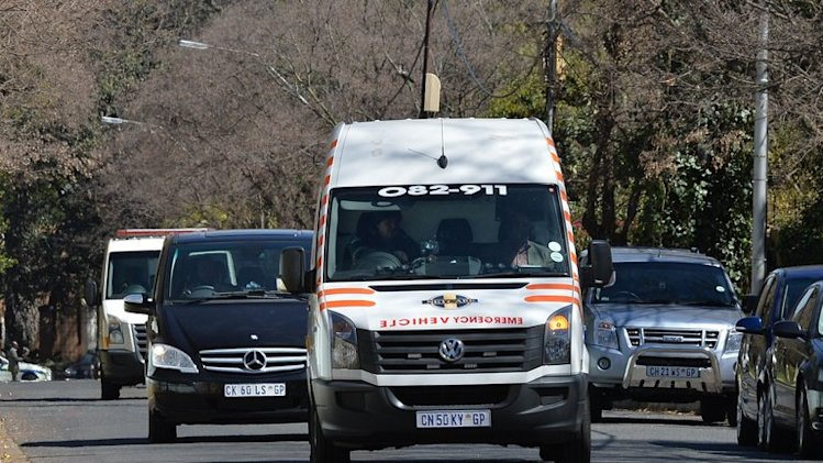 An ambulance carrying former South African president Nelson Mandela arrives at his home, September 1, 2013, Johannesburg