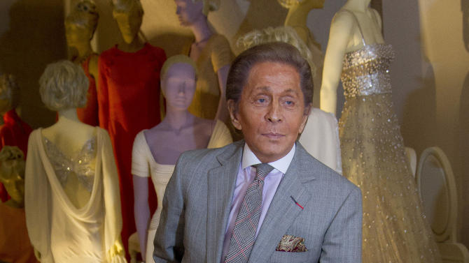 Italian designer Valentino poses for photographers during the 'Valentino: Master of Couture' Photocall at Somerset House in central London, Wednesday Nov. 28, 2012. Celebrating a 50-year career, the exhibition showcases over 130 hand-crafted designs worn by Grace Kelly, Sophia Loren and Gwyneth Paltrow. (Photo by Joel Ryan/Invision/AP)