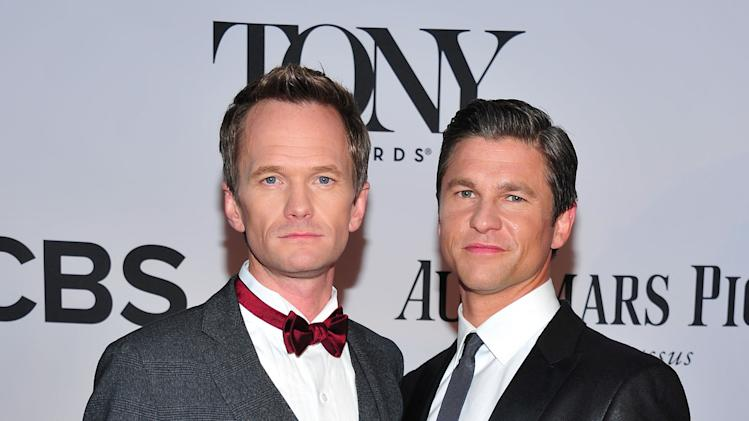 Neil Patrick Harris, left, and David Burtka arrives on the red carpet at the 67th Annual Tony Awards, on Sunday, June 9, 2013 in New York.  (Photo by Charles Sykes/Invision/AP)