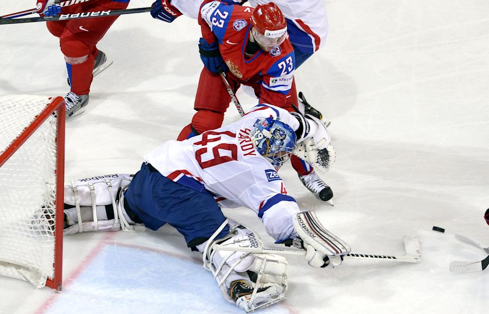 French goalie Florian Hardy saves a shot from Russian Denis Kokarev (23)  during  the 2013 Ice Hockey World Championships preliminary round match Russia vs France in Helsinki, Finland on Thursday, May 9, 2013.  (AP Photo / LEHTIKUVA / Heikki Saukkomaa)  FINLAND OUT