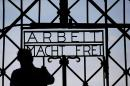 "A blacksmith prepares a replica of the Dachau Nazi concentration camp gate, with the writing ""Arbeit macht frei"" (Work Sets you Free) at the main entrance of the memorial in Dachau, Germany, Wednesday, April 29, 2015. The gate was stolen in November 2014. (AP Photo/Matthias Schrader)"