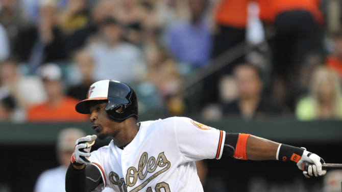 Baltimore Orioles' Adam Jones follows through on an RBI single against the Boston Red Sox in the third inning of a baseball game, Friday, June 14, 2013, in Baltimore. (AP Photo/Gail Burton)
