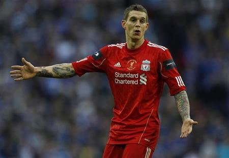 Liverpool's Agger reacts during their English League Cup final match against Cardiff City in London