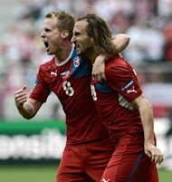 Czech midfielder Petr Jiracek and Czech forward Jan Rezek celebrate after scoring during the Euro 2012 championships football match Greece vs Czech Republic on June 12, 2012 at the Municipal Stadium in Wroclaw.  AFP PHOTO / ARIS MESSINIS
