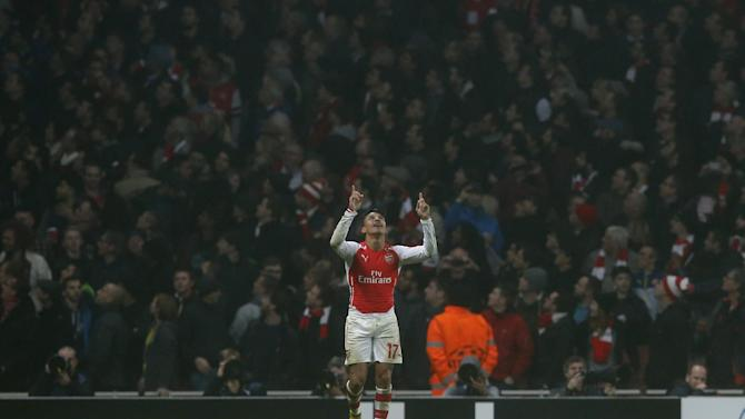 Arsenal's Alexis Sanchez celebrates scoring during the Champions League group D soccer match between Arsenal and Borussia Dortmund at the Emirates stadium in London, Wednesday, Nov. 26, 2014. (AP Photo/Alastair Grant)