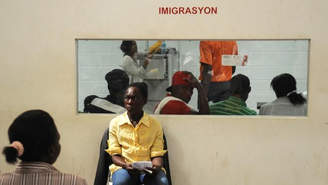 Haitian citizens, born in the Dominican Republic to immigrant parents, await their turn to be assisted in obtaining copies of their personal documents in Santo Domingo
