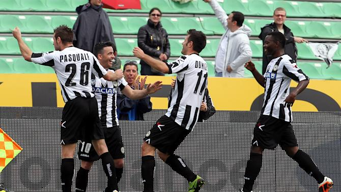 Udinese's Antonio Di Natale, center, celebrates after scoring, with teammates Giovanni Pasquale, left, Maurizio Domizzi and Asamoah, during the Serie A soccer match between Udinese and Genoa, at the Friuli Stadium in Udine, Italy, Sunday, May 6, 2012. (AP Photo/Paolo Giovannini)