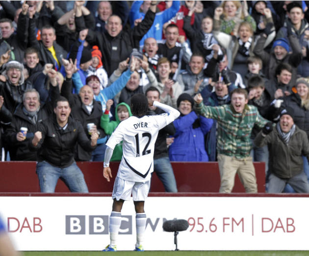 Swansea City's English Midfielder Nathan Dyer Celebrates With Supporters   RESTRICTED TO EDITORIAL USE. No Use With AFP/Getty Images
