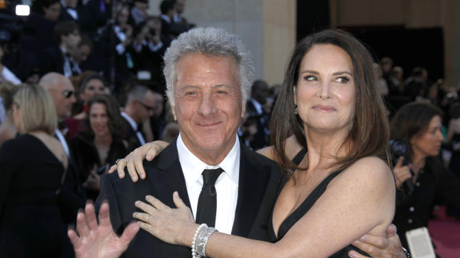 Actor Dustin Hoffman, left, and wife Lisa Hoffman arrives at the Oscars at the Dolby Theatre on Sunday Feb. 24, 2013, in Los Angeles. (Photo by Carlo Allegri/Invision/AP)