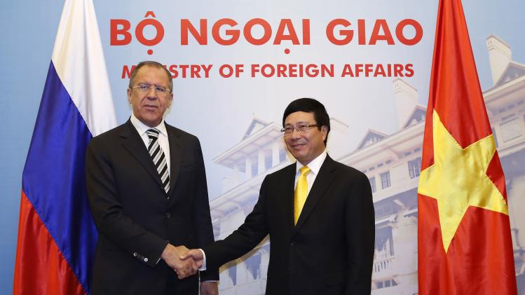 Russian Foreign Minister Sergei Lavrov shakes hands with his Vietnamese counterpart Pham Binh Minh at the Government Guest House in Hanoi